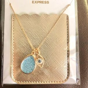 Teardrop pendant necklace with phone pocket.